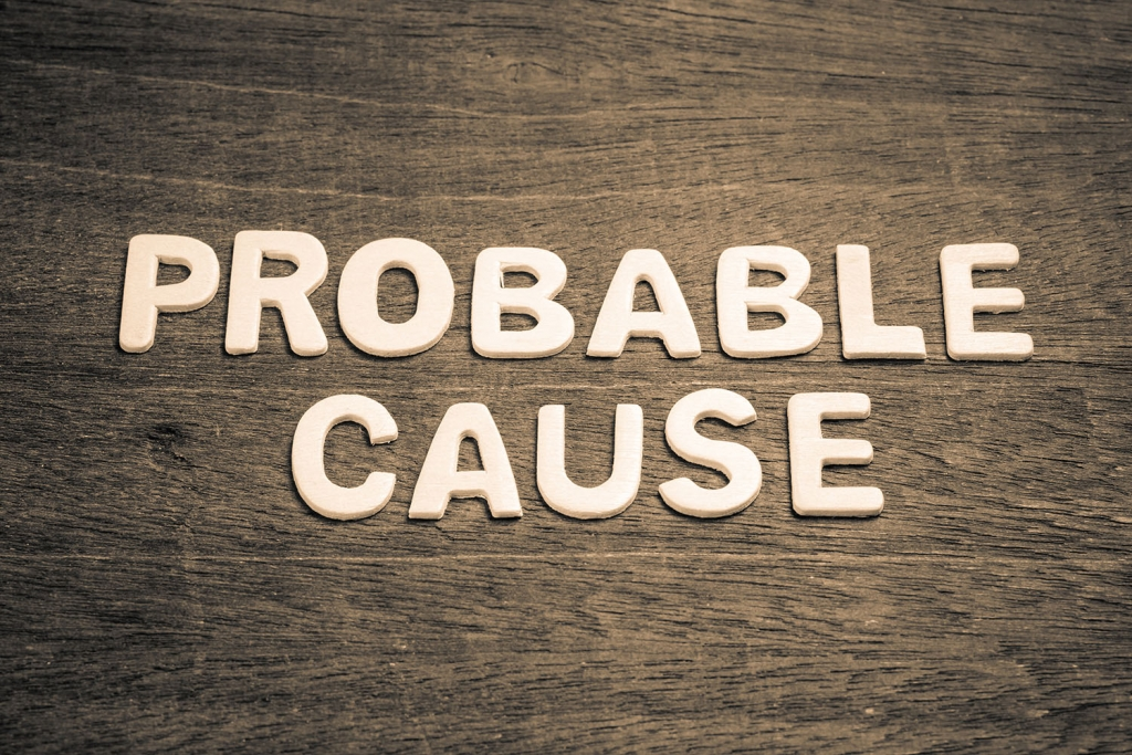 difference between probable cause and reasonable suspicion